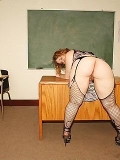 Excited teacher bends over..